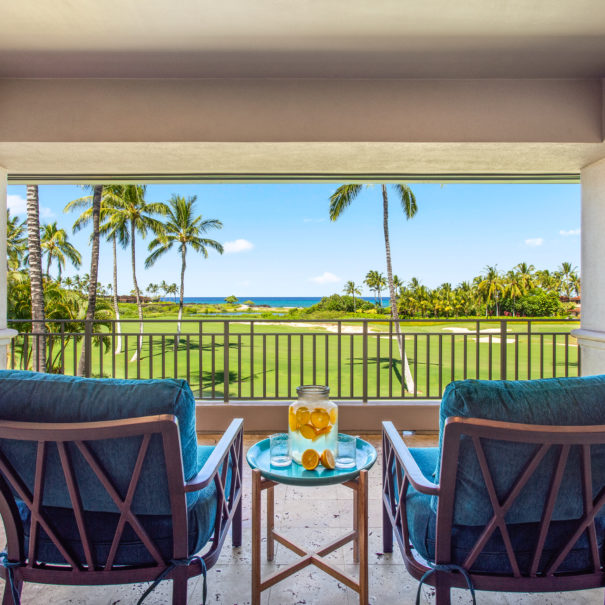 Tiled lanai on second floor showing a large cistern of water with orange slices between four comfortable outdoor chairs.